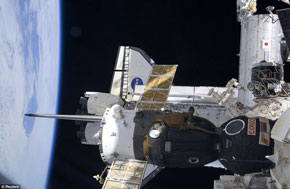 Space Shuttle Atlantis and Russian Soyuz docked side-by-side on the ISS