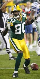 Donald Driver makes an acrobatic move against Dallas