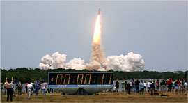 Shuttle Atlantis lifts off to repair the Hubble Telescope