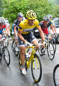 Fabian Cancellara and Lance Armstrong lead the parade as the peloton shuts down racing for the day