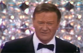 John Wayne accepts the Oscar for True Grit