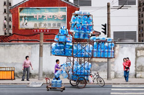 Unbelievable Stacks of Chinese Goods Piled High on Bikes