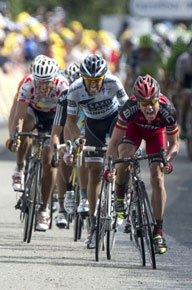 Evans leads Contador and Gilbert on the final charge up the hill
