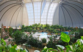 giant airship hanger turned into tropical resort