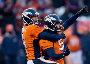 Matt Prater celebrates after kicking 64-yard field goal