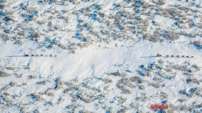 Aerial view of Jeff King leading Aliy Zirkle out of White Mountain
