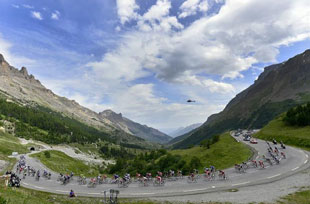 the peloton in the high Alps on stage 14 of the 2014 Tour de France