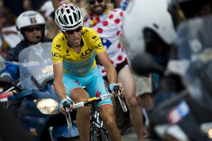 Vincenzo Nibali confirms his dominance of the 2014 Tour by attacking on the final climb and winning the stage