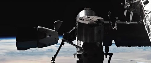 Dragon captured by robotic arm of ISS